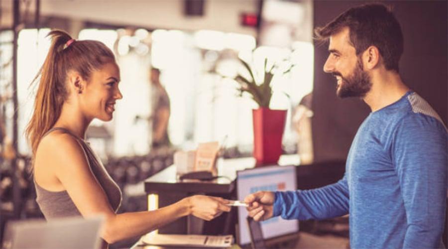 man-woman-gym-check-in-social-1